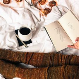 Reader with coffee and a book